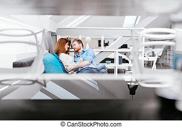 Couple lying on bed  enjoying time together