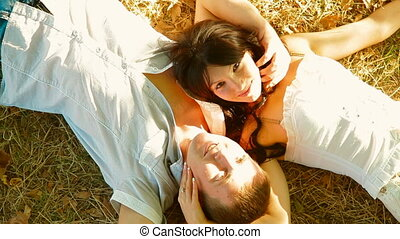 couple lying under a tree