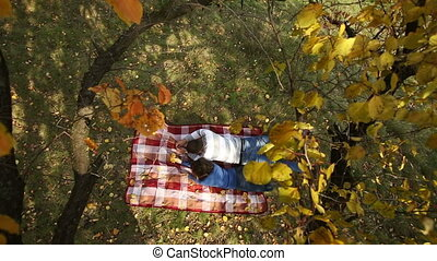 Couple Lying Under Autumn Tree