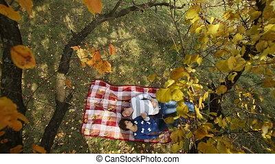 Couple Lying Under Autumn Tree