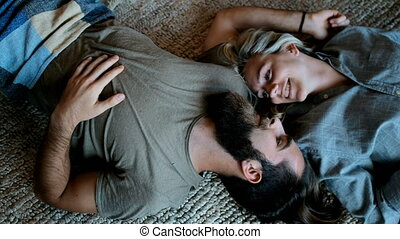 Couple lying upside down in living room 4k - Couple lying...
