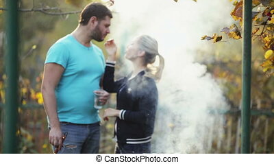 Couple make meat and fish in barbecue