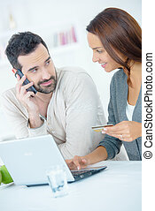Couple making an on-line payment