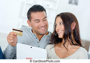 Couple making an on-line purchase