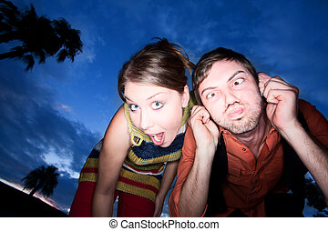 Couple making Funny Faces at Sunset