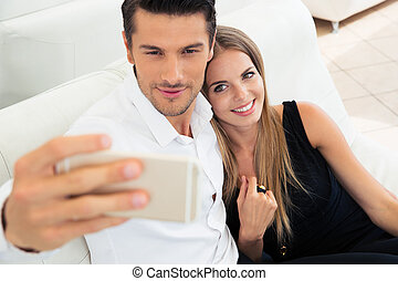 Couple making selfie photo on smartphone