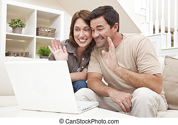 Couple Making VOIP Internet Phone Call on Laptop Computer