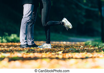 Couple Man and Woman Feet in Love. Happy young family concept. Lifestyle with nature on background.
