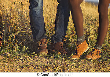 Couple man and woman feet in love romantic outdoor with autumn season nature on background