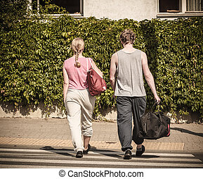 Couple man and woman with sport bags.
