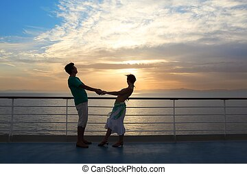 couple: man with woman on deck of cruise ship. sunset.