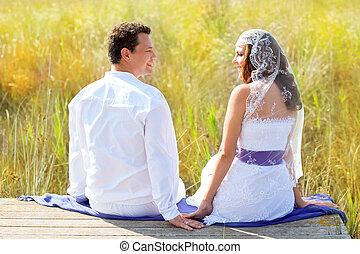 Couple mediterranean wedding day fashion in outdoor