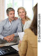 Couple meeting adviser at home