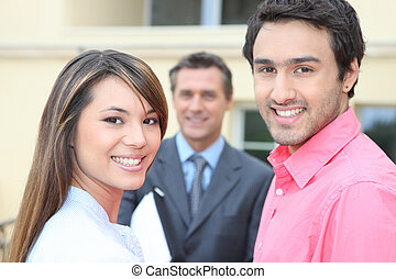 Couple meeting estate agent