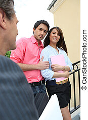 Couple meeting with a realtor