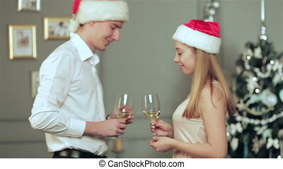 Couple meets with glasses of champagne