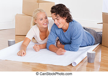 Couple moving in a new house