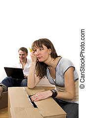 woman with sad expression leaning on box