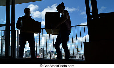 Couple moving into a new city home apartment