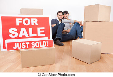 Couple moving into new house - Happy young couple moving...