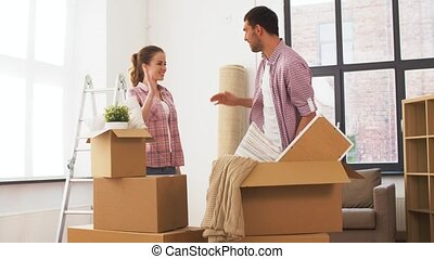 couple moving to new home and making high five