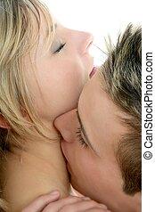 couple natural kiss closeup portrait