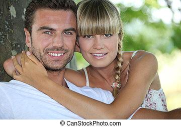 couple near a tree