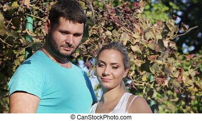 Couple near barbecue