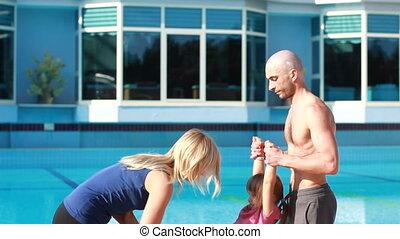 couple near the pool, couple yoga