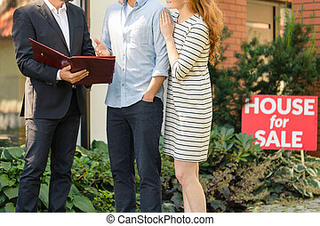 Couple negotiating with house seller