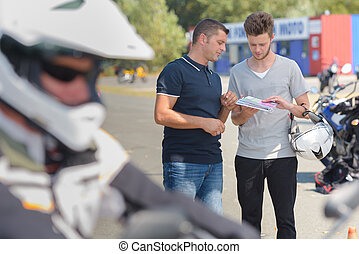 couple next to motorcycle