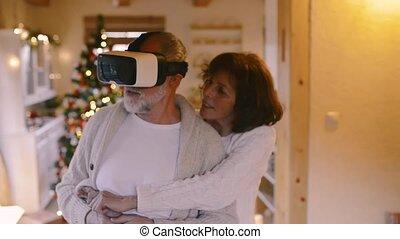 couple, noël, vr, arbre., devant, personne agee, goggles., homme
