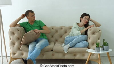 Couple not talking after a dispute on the sofa