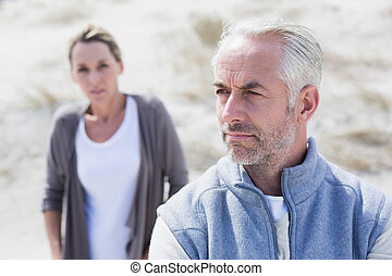 Couple not talking after argument on the beach