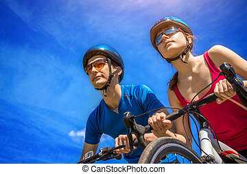 Couple of bikers against the sky