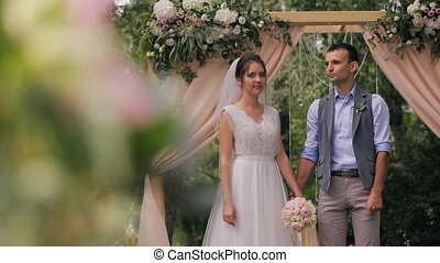 Couple of bride and groom during wedding outdoor registration in forest