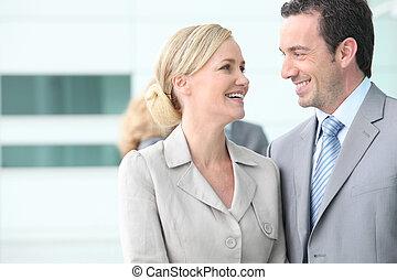 Couple of businesspeople gazing into eyes