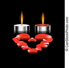couple of candles - black background and burning candles...