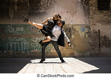 Couple of dancers looking at each other