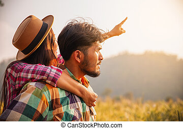 couple of farmers in a gold field standing in summer