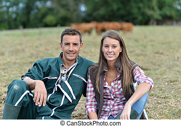 Couple of farmers sitting in field