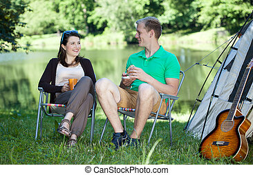 Couple of friends on a camping