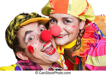 Couple of happy clowns isolated on white background