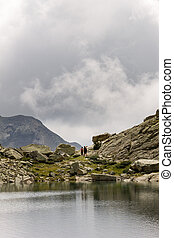 Couple of Hikers Walk Near the Lake