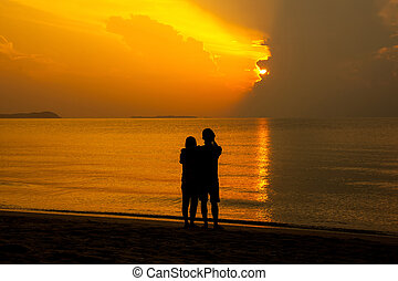 Couple of lover on the beach with sunrise