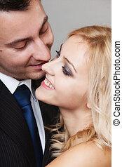 couple of lovers groom and bride studio shot