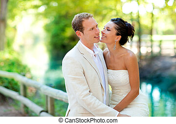 couple of lovers in love in park river hug