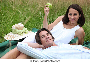 couple of lovers lying in grass
