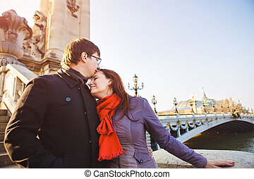 couple of lovers on Seine river in Paris. travel in spring in Europe.