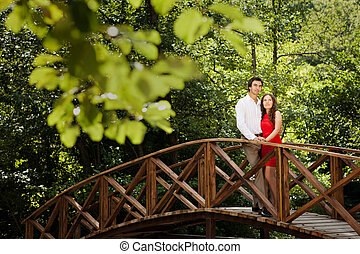 Couple of lovers on the bridge.